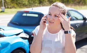 Female Driver Making Phone Call After an Accident