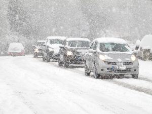 cars driving in heavy snow, winter driving